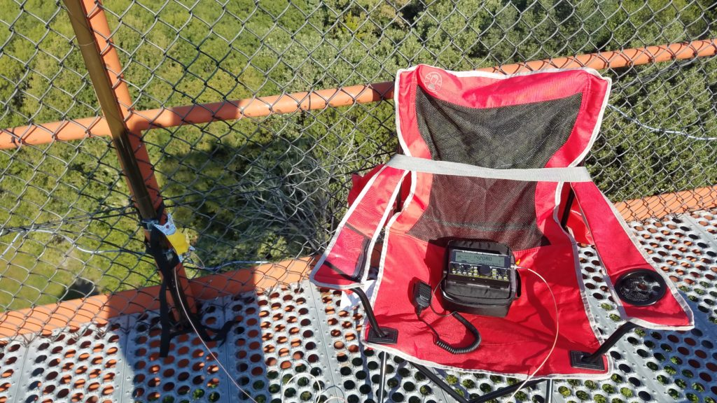 My operating position on top of the observation tower - the Elecraft KX2 HF radio transceiver attached to the PackTenna mini random wire antenna.
