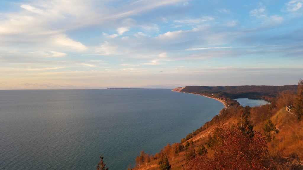View of the Lake Michigan and the Sleeping Bear Dunes National Lakeshore at sunset.